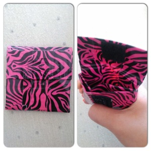 Change purse interior with two compartments and velcro closure.